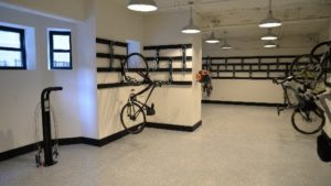 Picture of a bike hanging in a bike storage room